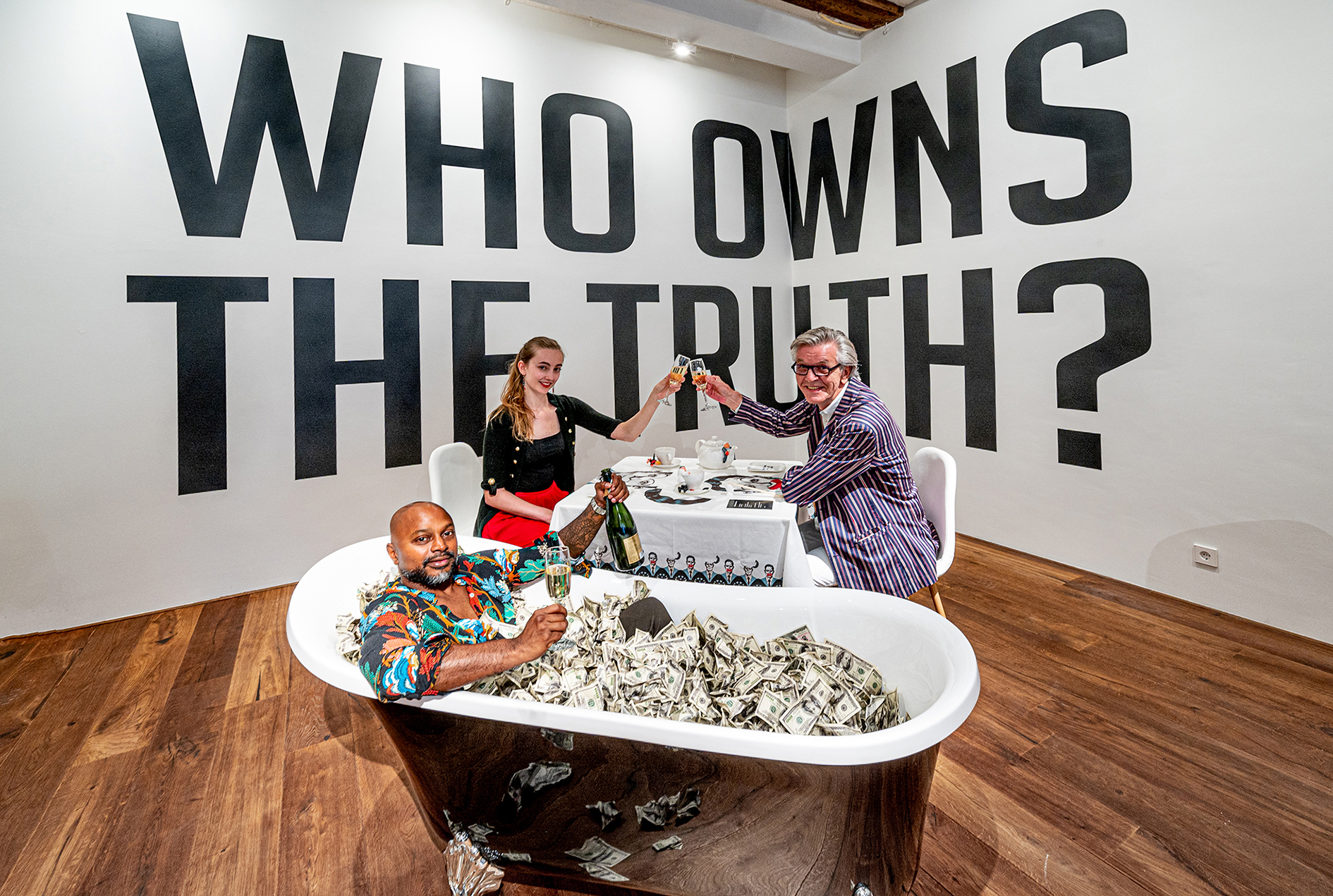 Visitors to the new activist art exhibition, 'Who Owns the Truth?'